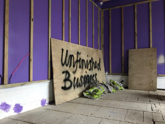 Sign for the group exhibition 'Unfinished Business'.
