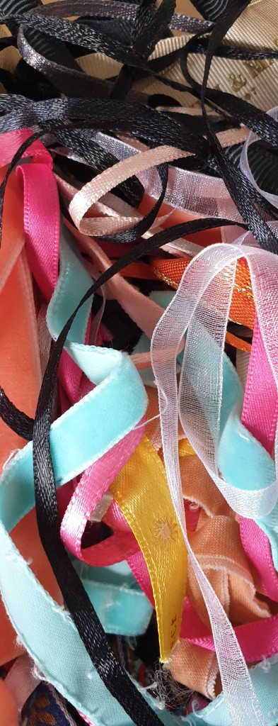 Tangled pile of coloured ribbons.